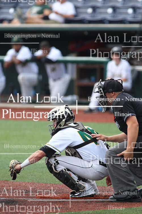07 June 2015:  Catcher Thomas Amato and umpire David Fields during a Frontier League Baseball game between the Southern Illinois Miners and the Normal CornBelters at Corn Crib Stadium on the campus of Heartland Community College in Normal Illinois