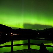 People watch a rare southern Northern Lights, or Aurora Borealis, display along the shore of Whistler's Green Lake.  Sunday, May 28, 2017.<br /> <br /> Photo:  David Buzzard