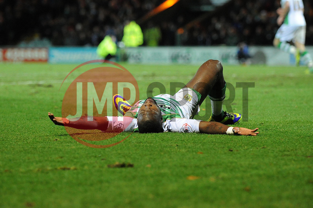Yeovil Town's Ishmael Miller lies on the floor after going down from a challenge - Photo mandatory by-line: Dougie Allward/JMP - Tel: Mobile: 07966 386802 21/12/2013 - SPORT - FOOTBALL - Huish Park - Yeovil - Yeovil Town v Blackburn Rovers - Sky Bet Championship