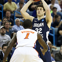 Mar 24, 2011; New Orleans, LA; Brigham Young Cougars guard Jimmer Fredette (32) is guarded by Florida Gators guard Kenny Boynton (1)  during the first half of the semifinals of the southeast regional of the 2011 NCAA men's basketball tournament at New Orleans Arena.  Mandatory Credit: Derick E. Hingle