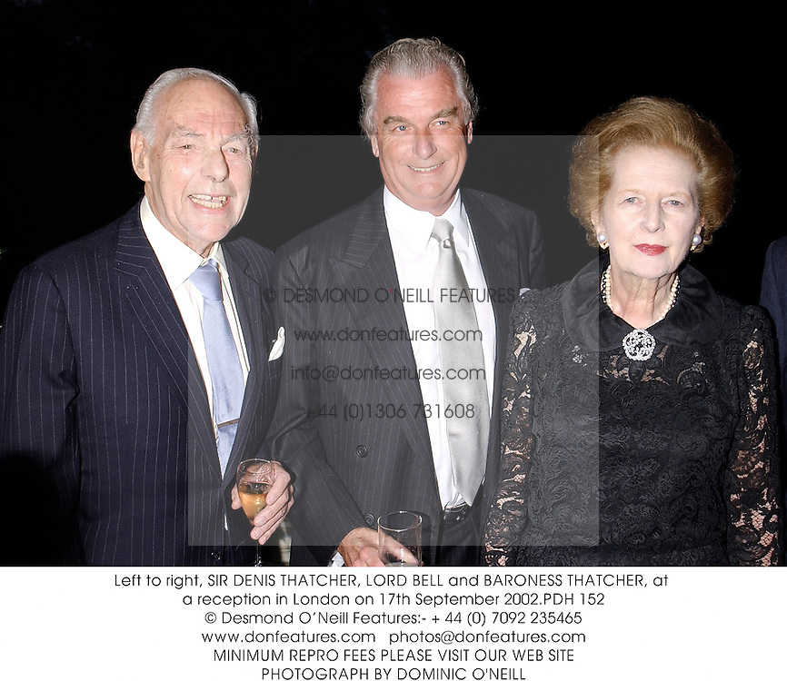 Left to right, SIR DENIS THATCHER, LORD BELL and BARONESS THATCHER, at a reception in London on 17th September 2002.	PDH 152