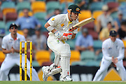 "David Warner takes a step after playing forward to the spin late on Day 2 of the 1st Test in the 2013-14 Ashes Cricket Series between Australia and England at the GABBA (Brisbane, Australia) from Thursday 21st November 2013<br /> <br /> Conditions of Use : NO AGENTS ~ This image is subject to copyright and use conditions stipulated by Cricket Australia.  This image is intended for Editorial use only (news or commentary, print or electronic) - Required Image Credit : ""Steven Hight - AURA Images"""