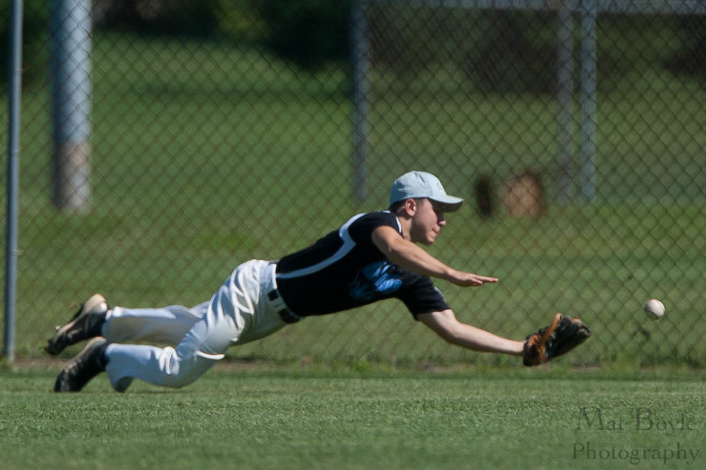 Pennsylvania's Nick O'Brien dives for a ball but comes up short on his dives and misses the catch during the finals of the Eastern Regional Senior League tournament between Pennsylvania and Maryland held in West Deptford on Thursday, August 11.