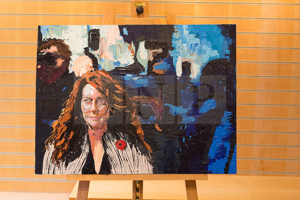 """© Licensed to London News Pictures. 27/06/2014. London, UK. An oil on canvas portrait of Rebekah Brooks, former editor of the News of the World titled """"Great day for red tops"""" in the Alexander Miles Gallery in St Katherine Docks, close to the News UK site in Wapping, East London. Gallery owner and curator Alex Miles says that the anonymous artist is a current and long standing senior member of editorial staff at News UK and that he has painted these portraits of his subjects as he has seen them for many years in the newspaper working environment. The artist, who wishes to remain anonymous at the present time is using a 'nom de plume' of Mark Felt. Photo credit : Vickie Flores/LNP."""