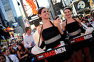 Actresses dressed as 60's era waitresses hand out candy as fans watch the world premiere screening 'Mad Men' Season 4 in Times Square on Sunday, July 25, 2010 in New York. Photo by Keith Bedford
