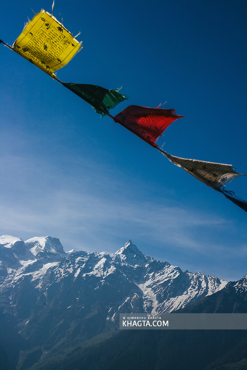 Prayer flags in front o f a beautiful Landscape of Kinnaur Kailash mountains from Kalpa, Kinnaur