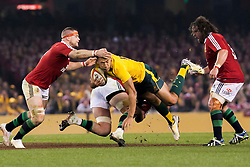 © Licensed to London News Pictures. 29/6/2013. Israel Folau gets tackled during the British & Irish Lions 2nd test between Qantas Wallabies Vs British & Irish Lions at Etihad Stadium, Melbourne, Australia. Photo credit : Asanka Brendon Ratnayake/LNP