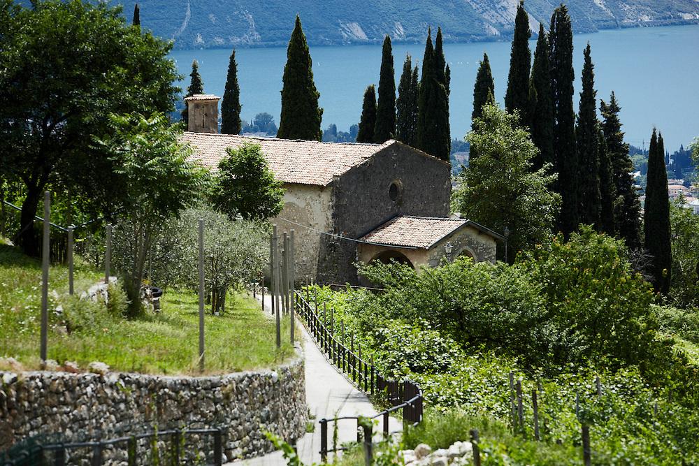 Tenno (TN) -  Chiesa di San Lorenzo e il  Lago di Garda.