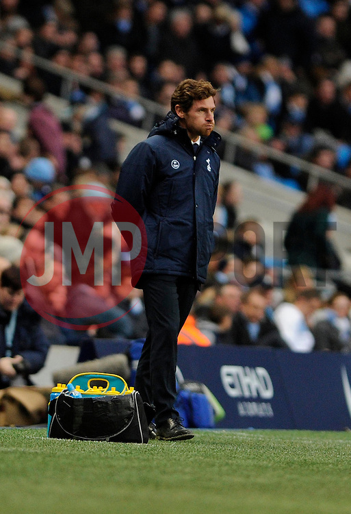 Tottenham Hotspur Manager, Andre Villas Boas blows his cheeks as Tottenham lose 6 - 0 - Photo mandatory by-line: Dougie Allward/JMP - Tel: Mobile: 07966 386802 24/11/2013 - SPORT - Football - Manchester - Etihad Stadium - Manchester City v Tottenham Hotspur - Barclays Premier League