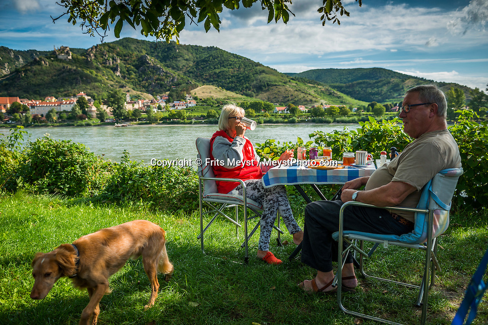 Rossatzbach, Danube, Lower Austria, September 2015. Camping Rossatz on the banks of the Danube River in Rossatzbach looks straight at Durnstein. Austria's most spectacular section of the Danube is the dramatic stretch of river between Krems an der Donau and Melk, known as the Wachau. Here the landscape is characterised by vineyards, forested slopes, wine-producing villages and imposing fortresses at nearly every bend. The Wachau is today a Unesco World Heritage site, due to its harmonious blend of natural and cultural beauty. Photo by Frits Meyst / MeystPhoto.com