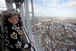 "© Licensed to London News Pictures. 10/10/2013. London, UK. Pearly Kings and Queens look at London from ""The View"" at the top of the Shard in London today (10/10/2013). Forming part of a London tradition, the Kings and Queens, were given a free pass to look at the capital from one of Europe's highest buildings to celebrate their ongoing commitment to charity work in London as they gear up for the annual Harvest Festival in Covent Garden taking place this weekend. Photo credit: Matt Cetti-Roberts/LNP"