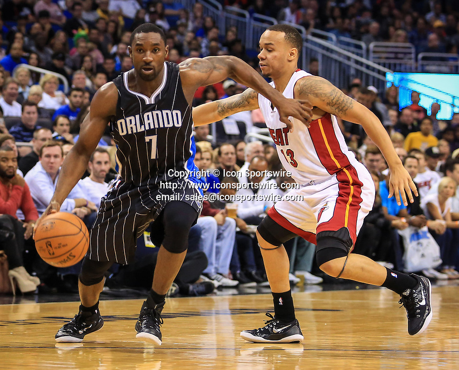 Nov. 22, 2014 - Orlando, FL, USA - The Orlando Magic's Ben Gordon (7) drives past the Miami Heat's Shabazz Napier (13) during first-quarter action at Amway Center in Orlando, Fla., on Saturday, Nov. 22, 2014. The Heat won, 99-92.