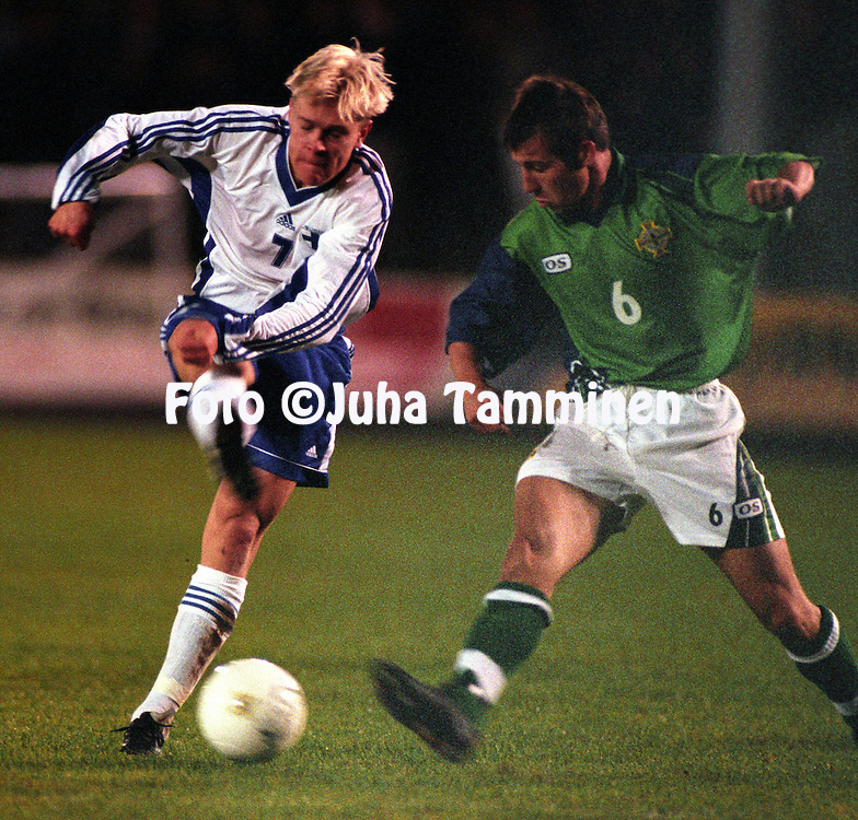 09.10.1998, Ballymena, Northern Ireland. .Olympic / UEFA Under-21 European Championship qualifying match, Northern Ireland v Finland. .Jari Niemi scores for Finland, David Waterman is late..©JUHA TAMMINEN