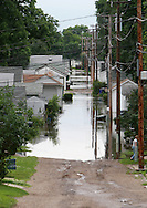 Massive flooding has covered the Midwest section of the United States. In Cedar Rapids, Iowa over 400 blocks were underwater. Other towns are now bracing for the water as it continues downstream.///A flooded alley in Cedar Rapids, Iowa.