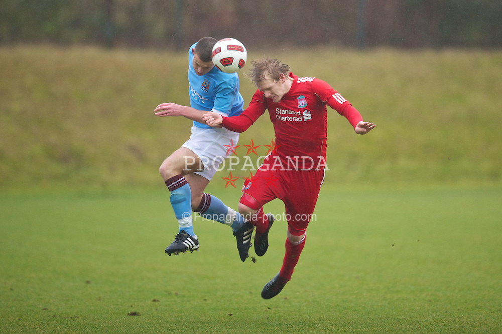KIRKBY, ENGLAND - Saturday, February 5, 2011: Liverpool's Patrik Poor in action against Manchester City's Harry Bunn during the FA Academy Under 18s League at the Kirkby Academy. (Photo by David Rawcliffe/Propaganda)