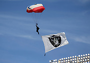 Sep 30, 2018; Oakland, CA, USA;  The Navy Parachute Team, the Leap Frogs, perform prior to a game between the Oakland Raiders and the Cleveland Browns. The Raiders defeated the Browns 45-42 in overtime. Mandatory Credit: Spencer Allen-Image of Sport