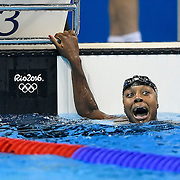United States swimmer Simone Manuel reacted to seeing her final time tied for first in the women's 100m freestyle final, sharing the medal with Canada's Penny Oleksiak on Thursday at the Olympic Aquatics Stadium during the 2016 Summer Olympics Games in Rio de Janeiro, Brazil.