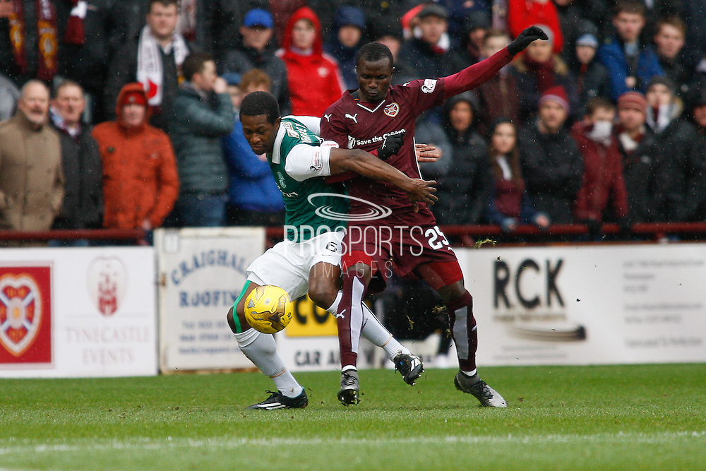 Hibernian FC Midfielder Marvin Bartley takes on Hearts FC Midfielder Abiola Daud during the Scottish Cup 5th round match between Heart of Midlothian and Hibernian at Tynecastle Stadium, Gorgie, Scotland on 7 February 2016. Photo by Craig McAllister.