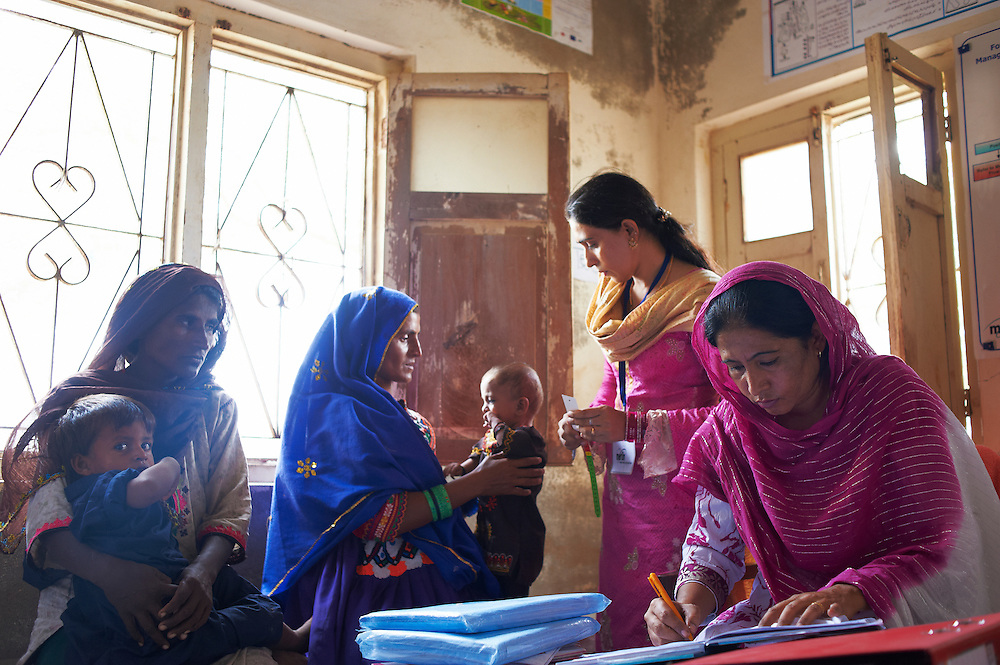 Health workers treat patients in the  Tarqwaja Government Dispensary, Thatta, Sindh, Pakistan on June 30, 2011.
