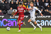 Ashley Fletcher (11) of Middlesbrough on the attack with Mike van der Hoorn (5) of Swansea City challenging him during the EFL Sky Bet Championship match between Swansea City and Middlesbrough at the Liberty Stadium, Swansea, Wales on 14 December 2019.