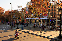 Late afternoon sun hits the La Ramblas in the heart of Barcelona, Spain.
