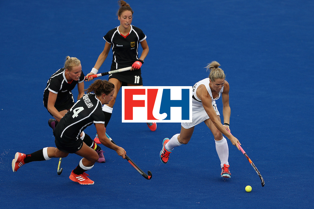RIO DE JANEIRO, BRAZIL - AUGUST 08:  Janne Muller-Wieland #14, Hannah Kruger #15 and Lisa Schutze #11 of Germany defend against Stacey Michelsen #31 of New Zealand during a Women's Pool A match on Day 3 of the Rio 2016 Olympic Games at the Olympic Hockey Centre on August 8, 2016 in Rio de Janeiro, Brazil.  (Photo by Sean M. Haffey/Getty Images)