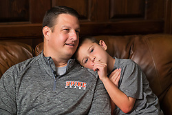 Kelly Wells, left, and son Mason talk with CJ writer Michael Grant about the latest chapter in his life as he lives with a rare kidney disorder called Berger's Disease, Wednesday, Sept. 24, 2014 at the Wells' Home in Pikeville. <br /> <br /> Kelly suffers from a kidney disorder called Berger's Disease. His newly transplanted functioning kidney was donated by his sister's husband.<br /> <br /> Ten years after donating her kidney to her husband it began to reject the organ. <br /> <br /> While searching for a donor Shawne's brother was screened as a possible match and a CT Scan revealed he had cancer, which was a shock but had it not been for the screening the detection may have not been made for a long time.<br /> <br /> Photo by Jonathan Palmer, Special to the CJ