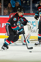 KELOWNA, CANADA - DECEMBER 5:  Devin Steffler #4 of the Kelowna Rockets skates with the puck against the Tri-City Americans on December 5, 2018 at Prospera Place in Kelowna, British Columbia, Canada.  (Photo by Marissa Baecker/Shoot the Breeze)