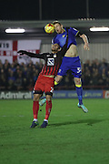 AFC Wimbledon defender Chris Robertson (34) and Coventry City midfielder Ivor Lawton (26) during the EFL Sky Bet League 1 match between AFC Wimbledon and Coventry City at the Cherry Red Records Stadium, Kingston, England on 14 February 2017. Photo by Stuart Butcher.