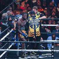 Deontay Wilder rests in his corner between rounds against Luis Ortiz during the WBC Heavyweight Championship boxing match at Barclays Center on Saturday, March 3, 2018 in Brooklyn, New York. Wilder would win the bout by knockout in the tenth round to retain the title and move to 40-0. (Alex Menendez via AP)