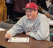Lamar's John Fallon (Harvard) smiles after signing his certificate of intent during a National Signing Day ceremony at the Region 4 Education Center, February 5, 2014.