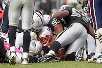02 October 2011: Runningback (22) Stevan Ridley of the New England Patriots looks out of the pile after being tackled by the Oakland Raiders during the second half of the Patriots 31-19 victory against the Raiders in an NFL football game at O.co Stadium in Oakland, CA.
