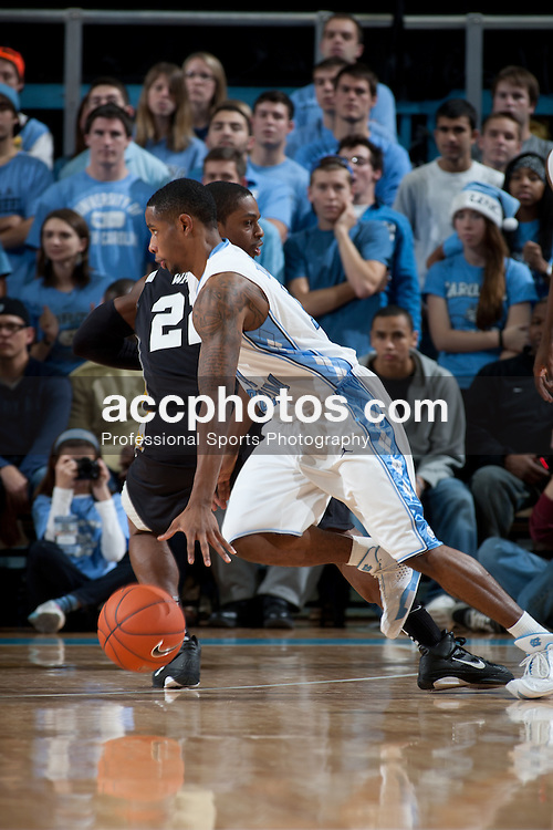 CHAPEL HILL, NC - DECEMBER 11: Larry Drew II #11 of the North Carolina Tar Heels dribbles the ball while playing the Long Beach State 49ers at the Dean E. Smith Center in Chapel Hill, North Carolina. North Carolina won 96-91.
