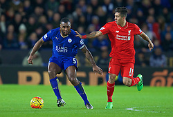 LEICESTER, ENGLAND - Monday, February 1, 2016: Liverpool's Roberto Firmino in action against Leicester City's captain Wes Morgan during the Premier League match at Filbert Way. (Pic by David Rawcliffe/Propaganda)