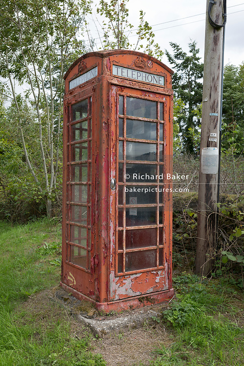 A now disused peeling old K2 telephone box kiosk, on 10th September 2018, near Lingen, Herefordshire, England UK.