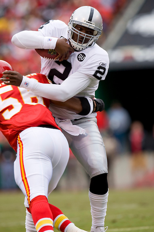 KANSAS CITY, MO - SEPTEMBER 14:   JaMarcus Russell #2 of the Oakland Raiders is hit by Derrick Johnson #56 of the Kansas City Chiefs at Arrowhead Stadium on September 14, 2008 in Kansas City, Missouri.  The Raiders defeated the Chiefs 23-8.  (Photo by Wesley Hitt/Getty Images) *** Local Caption *** JaMarcus Russell; Derrick Johnson
