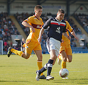 A bloodied Colin Nish goes past Motherwell's Fraser Kerr - Dundee v Motherwell, Clydesdale Bank Scottish Premier League at Dens Park.. - © David Young - 5 Foundry Place - Monifieth - DD5 4BB - Telephone 07765 252616 - email: davidyoungphoto@gmail.com - web: www.davidyoungphoto.co.uk