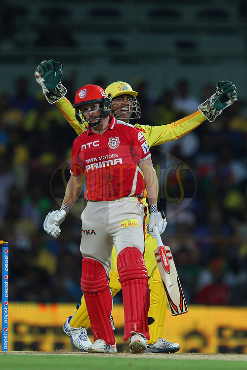 MS Dhoni captain of the Chennai Superkings celebrates the wicket of George Bailey Captain of Kings XI Punjab  during match 24 of the Pepsi IPL 2015 (Indian Premier League) between The Chennai Superkings and The Kings XI Punjab held at the M. A. Chidambaram Stadium, Chennai Stadium in Chennai, India on the 25th April 2015.<br /> <br /> Photo by:  Ron Gaunt / SPORTZPICS / IPL