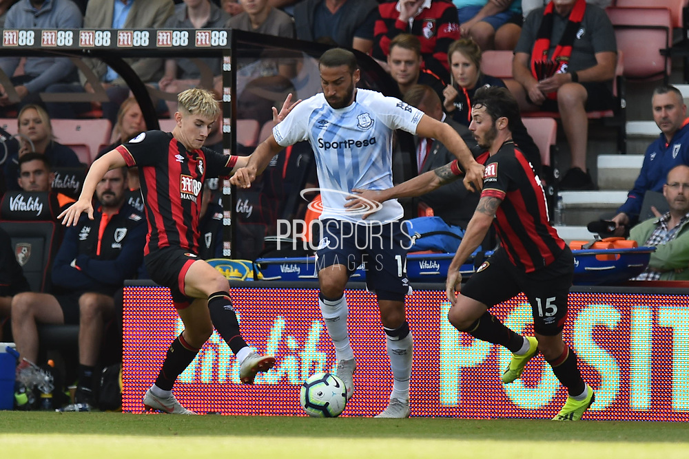 Cenk Tosun (14) of Everton takes on David Brooks (20) of AFC Bournemouth and Adam Smith (15) of AFC Bournemouth during the Premier League match between Bournemouth and Everton at the Vitality Stadium, Bournemouth, England on 25 August 2018.