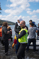 One million asylum seekers, many of them refugees from Syria, Iraq, and Afghanistan, crossed to Europe by sea in 2015. Half of these came via the Greek island of Lesbos, which is located in the Aegean Sea and has a resident population of about 86,000 people.<br /> <br /> __________<br /> <br /> <br /> Wanting to keep to a tight budget, I did not rent a car like many journalists covering the migrant crisis on Lesbos. I had only one day to work on the island&rsquo;s north coast and gambled that I would be able to hitch a ride from the town where I stayed to the beaches where boats would likely land. It turned out to be not as easy I had hoped, but in time a van of three Norwegians gave me a lift, and many of the pictures I took this day are thanks to their vehicular hospitality.<br /> <br /> They had arrived the night before from Norway, and I asked why they had come. The man who drove the van and is seen carrying the girl in this picture &mdash; I no longer remember his name &mdash; answered something like this: &ldquo;I watch the news like everyone else. You watch it and you see that there is a crisis and then you ask yourself if you can do anything to help. The answer is yes, you can help. Next I called my friends and said we need to respond to this tragedy. Each one agreed. We booked a ticket, took time off work, and here we are.&rdquo;