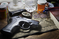Beretta 9mm PX4 Storm semi-automatic pistol on bedside nightstand