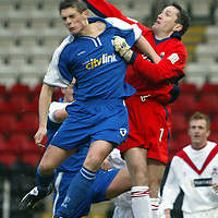 Airdrie v St Johnstone..  25.01.03<br />Mark McGeown clears from Ross Forsyth<br /><br />Pic by Graeme Hart<br />Copyright Perthshire Picture Agency<br />Tel: 01738 623350 / 07990 594431