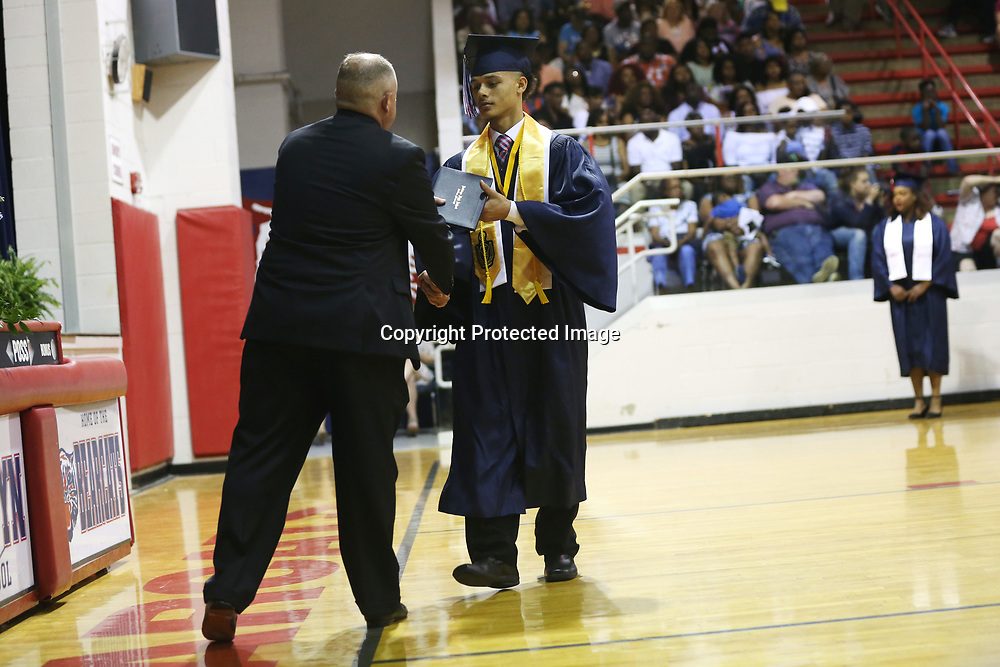 Baldwyn High School senior Christopher Hurd receives his diploma from superintendent Jason McKay during Friday night's graduation ceremony at the school.