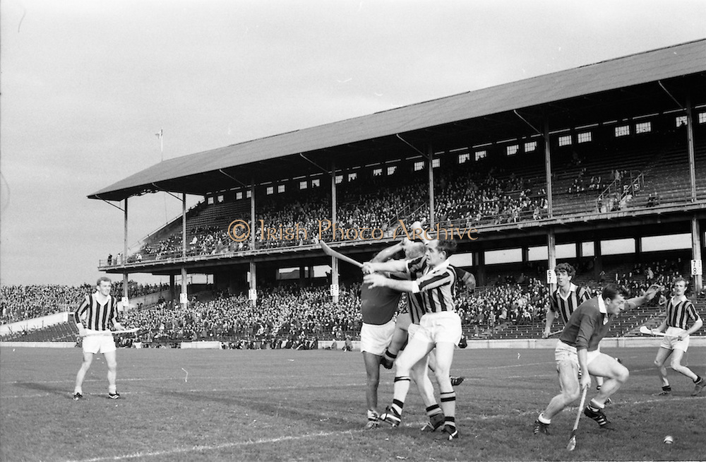 02/11/1969<br /> 11/02/1969<br /> 2 November 1969<br /> Oireachtas Hurling Final: Cork v Kilkenny at Croke Park, Dublin.<br /> Kilkenny back, T. Carrall, tackling Cork forwrad, E. OBrien.