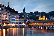 Church of St. Leodegar, the Chapel Bridge, Reuss River, and the Rathausquai of Lucerne, Switzerland.