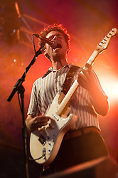 © Licensed to London News Pictures. 20/07/2014. Southwold, UK.   Parquet Courts performing live at Latitude Festival 2014 on Day 3.  In this picture -  Andrew Savage.  The Latitude Festival is a British annual music festival.  Photo credit : Richard Isaac/LNP