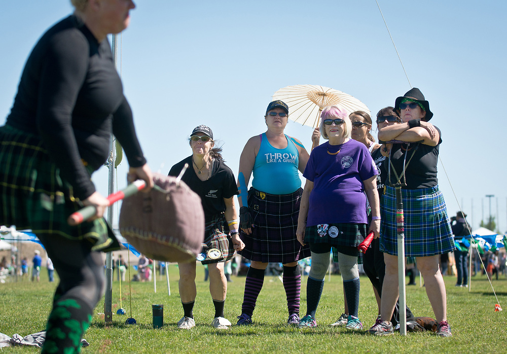mkb052017l/metro/Marla Brose --  Sheaf Toss competitors  in the women's master class, cheer on Katy Horgan as she attempt to toss a twine and burlap bag over a bar using a sheaf fork duirng the 29th Annual Rio Grande Valley Celtic Festival at Balloon Fiesta Park in Albuquerque, N.M., Saturday, May 20, 2017. Watching Horgan, from left, is Edie Lindeburg, Mona Malec, Donna Thompson and Linda Hughes. The event, which includes competitions, music, dancing and other Celtic traditions will continue Sunday. (Marla Brose/Albuquerque Journal)