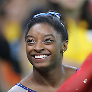 Gymnastics - Olympics: Day 6 Simone Biles #391 of the United States reacts as the final result comes through confirming gold during the Artistic Gymnastics Women's Individual All-Around Final at the Rio Olympic Arena on August 11, 2016 in Rio de Janeiro, Brazil. (Photo by Tim Clayton/Corbis via Getty Images)