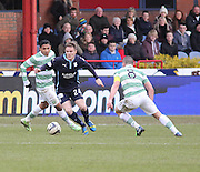 Dundee's Andy Black does past Celtic&rsquo;s Emilio Izaguirre and Scott Brown - Dundee v Celtic, William Hill Scottish Cup fifth round at Dens Park <br /> <br /> <br />  - &copy; David Young - www.davidyoungphoto.co.uk - email: davidyoungphoto@gmail.com