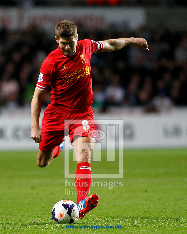 Picture by Mike  Griffiths/Focus Images Ltd +44 7766 223933<br /> 16/09/2013<br /> Steven Gerrard of Liverpool shoots from distance during the Barclays Premier League match at the Liberty Stadium, Swansea.